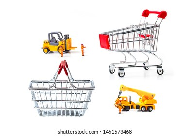 Miniature Worker Passenger  by Truck and forklift to shopping basket isolated on white background ,  Image for Christmas Holiday and Happy New Year Gift Celebration concept.