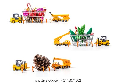 Miniature Worker Passenger Christmas box and pine cone by Truck and forklift to shopping basket isolated on white background ,  Image for Christmas Holiday and Happy New Year Gift Celebration concept.