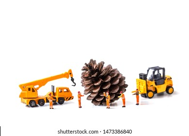 Miniature Worker Passenger Christmas   pine cone by Truck and forklift isolated on white background ,  Image for Christmas Holiday and Happy New Year Gift Celebration concept.