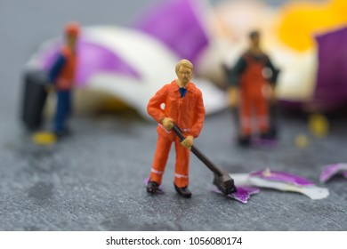 miniature worker people working on egg cleaning concept