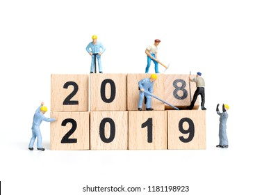 Miniature worker team building number 2019 on white background , Happy new year 2019 concept
