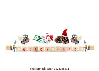 Miniature worker with wood block and pine cone , euro banknote isolated on white background ,  Image for Christmas Holiday and Happy New Year Gift Celebration concept.