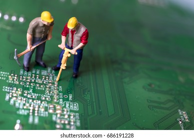 Miniature Workers On Circuit Board