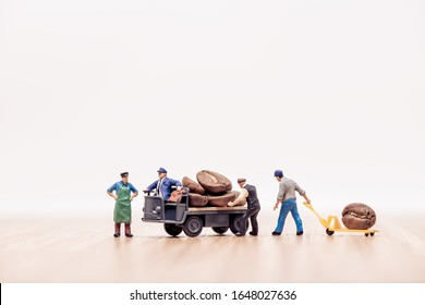 Miniature workers with truck loaded with coffee beans