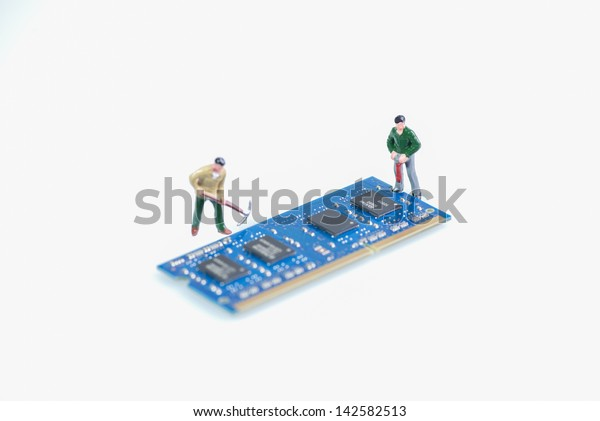 Miniature workmen working on the computer RAM or Random Access Memory part over white background