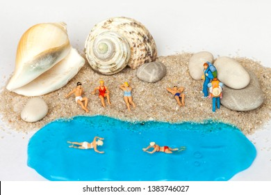 Miniature world: people in different situations taking a holiday at the beach. Summer lifestyle, vacation and tourism concept