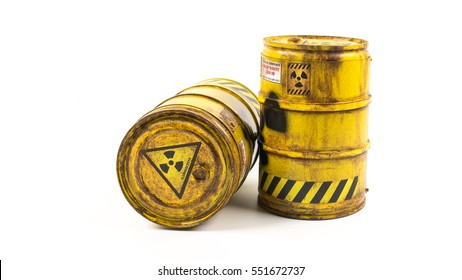 Miniature of yellow barrel or radioactive drum. Concept of biohazard or waste liquid. Isolated on white background. Slightly de-focused and close-up shot. Copy space.