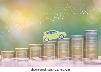 Miniature yellow car model on growing stack of coins money on nature green background, Saving money for car, Finance and car loan, Investment and business concept