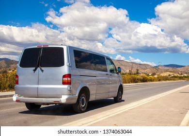 Minibus on the road. Commercial transport. Passenger Transportation. Journey. Road. Car tourism.