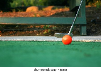 Mini-golf ball and putter