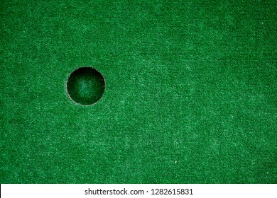 minigolf hole. photo close up. man playing golf
