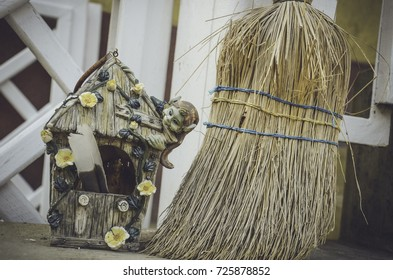 Mini-house decoration with witch on top and broom at the parlor