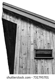 A minimal black & white photograph of a wooden building with a small window.