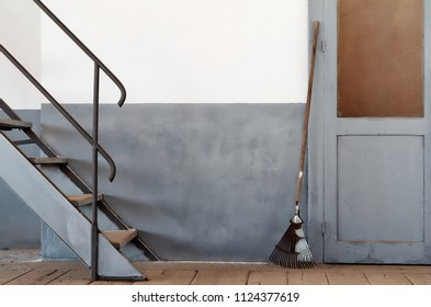 Minimal composition with broom stairs and door