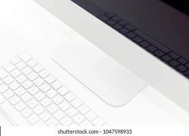 Minimal computer design on the desktop close up.