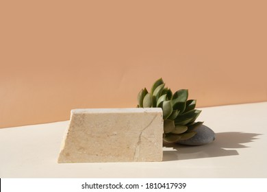 Minimal modern product display on beige background with podium