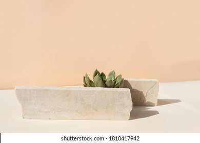 Minimal modern product display on textured beige background with podium