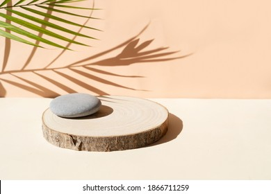 Minimal modern product display on textured beige background with shadows overlay and natural podium - Shutterstock ID 1866711259