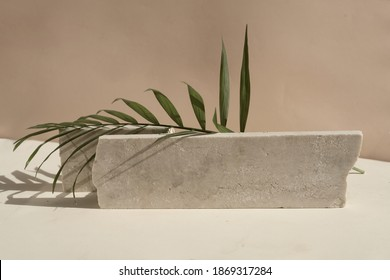Minimal modern product display on neutral beige background with podium with palm leaves, toned