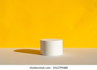 Minimal modern product display on trendy gray and yellow background with shadows