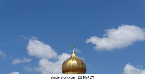 minimal mosque muslim achitecthure dome minaret with large blue sky with white cloud background  suitable for text space.
