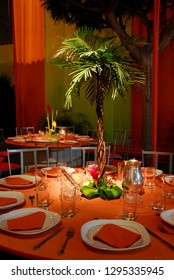 Minimal palm tree table centrepiece with orange thematic.
