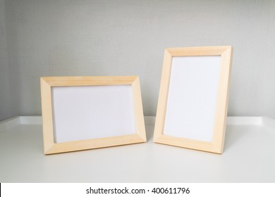 The minimal style of decoration by twin wooden picture frame