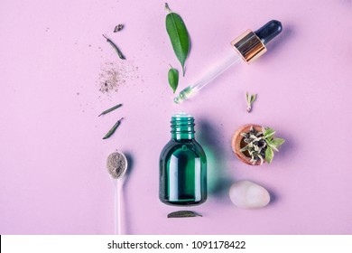 The minimal style. Vegetable extract, essential oil , vegetable serum in a bottle a pipette. The concept of being young. Flat lay