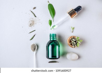 The minimal style. Vegetable extract, essential oil , vegetable serum in a bottle with a pipette. The concept of being young. Flat lay.