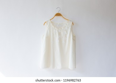 Minimal style.white lace with blouse is clothes hanging on white background.