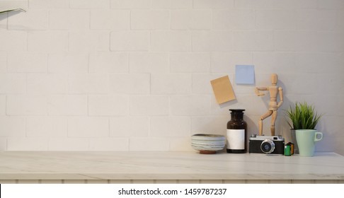 Minimal stylish workplace with copy space and decorations in white brick wall background