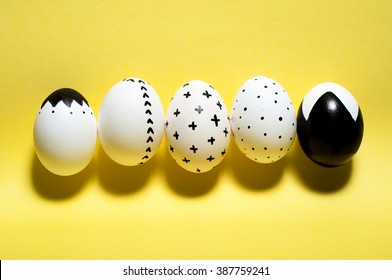 minimal trendy graphic modern monochome easter eggs on solid yellow background. easter postcard invitation