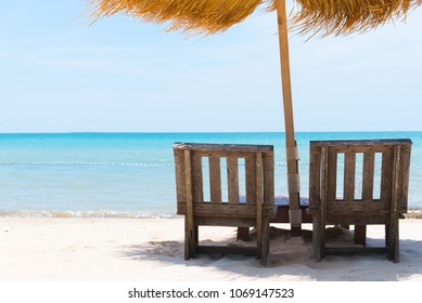 minimal two couple relax wood chair is place on clear island beach in front of sea view outside resort in slow easy sunny summer using for copy space romantic honeymoon and hotel booking in vacation