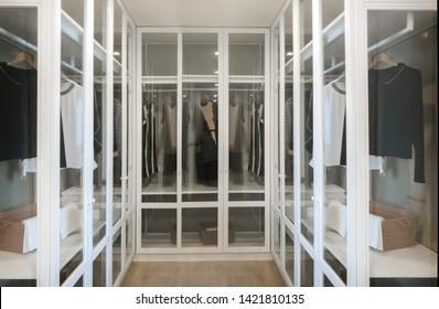minimal walkin in closet interior dressing room in modern house