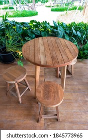 minimal wooden dining table and chairs on patio
