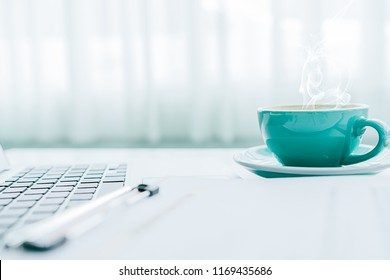 Minimal work space desk, office desk with laptop, notebooks and coffee cup on  white background view with copy space