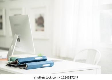Minimal work space desk, office desk with modern computer and note book on white background view with copy space