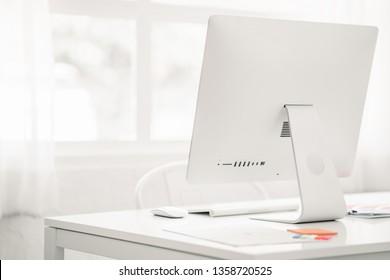 Minimal work space desk, office desk with modern computer on white background view with copy space