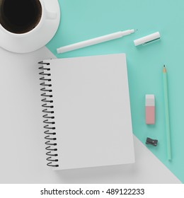 Minimal work space : sketchbook , a cup of coffee , rubber , white pen and green pastel pencil on green pastel cross white background. Top view , flat lay