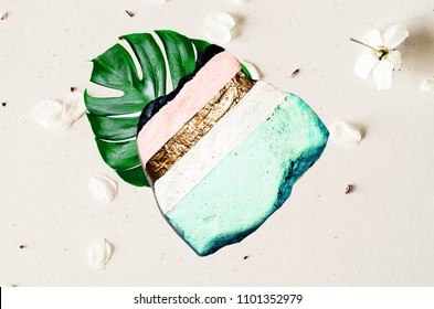 Minimalism. Art and Gold. Painting stone texture. Trendy colors. Abstract floral card. Punchy pastel. Millennial Pink with golden paint.
