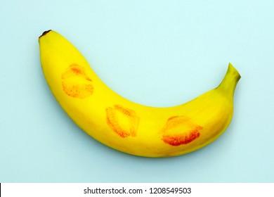 minimalism, banana in lipstick from kisses symbolizing sex