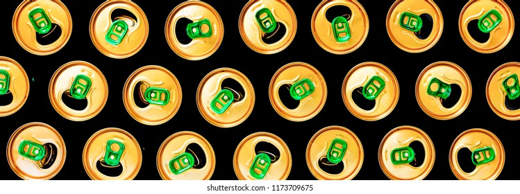 Minimalism. Beer cans on a black background. Pattern. Concept: modern, accent, original approach, creativity, idea