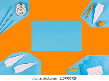 MINIMALISM. mock school timetable. time management concept. school stationery, plane on orange paper background. design layout. top view. flat lay,