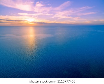 Minimalist aerial seascape - sunset over calm water