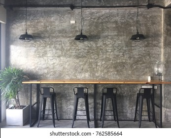 Minimalist cafe in loft style , table  bar and  chairs