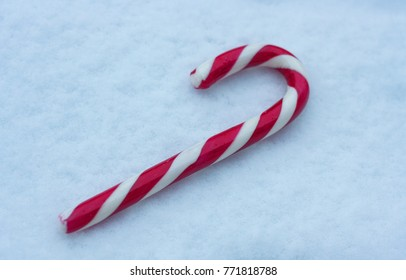 Minimalist Christmas candy on the white snow