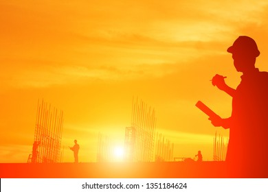 Minimalist of construction worker on construction site on sunset sky background.