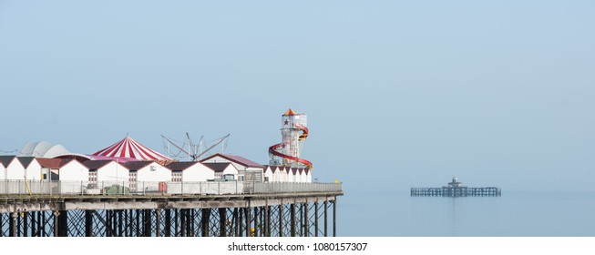 Minimalist fine art panorama image of colorful pier in juxtaposition with old derelict pier in background