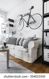 Minimalist hipster space with bicycle on wall