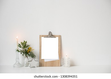 Minimalist home decor with empty frame mock-up on white wall background
